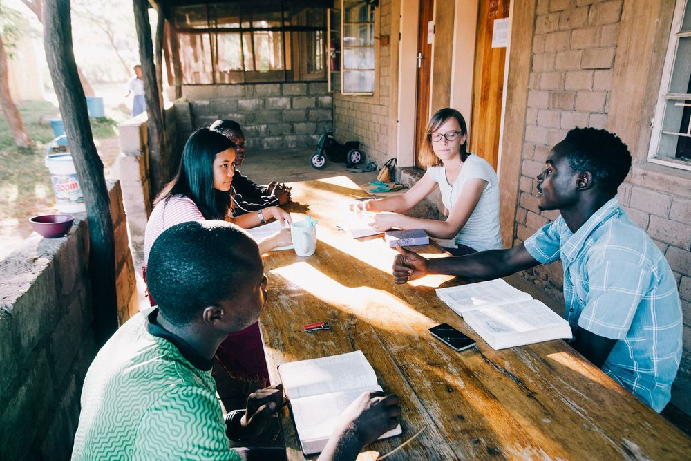 Zambia: Ivy, in the striped shirt on the left, does a Bible study at Lake Tanganyika. Photo by Doseong Park. More Info