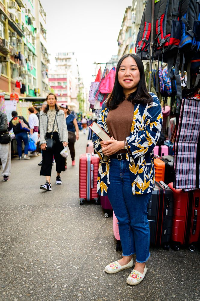 Hong Kong: Staff worker in the streets where she works. More Info