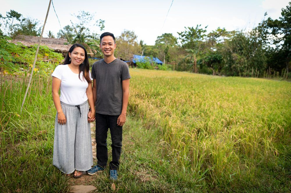 Philippines: Portrait of Philip and Levy Lim who lead the ministry in Palawan standing in the farm. Photo by Alex Coleman. More Info