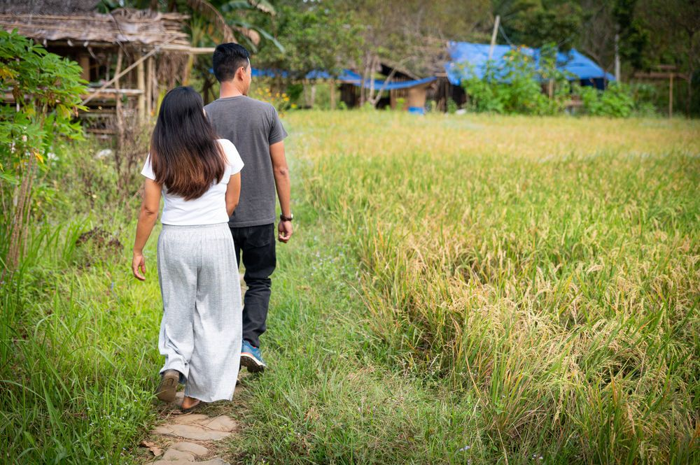 Portrait of Philip and Levy Lim who lead the ministry in Palawan walking through the farm. Photo by Alex Coleman.