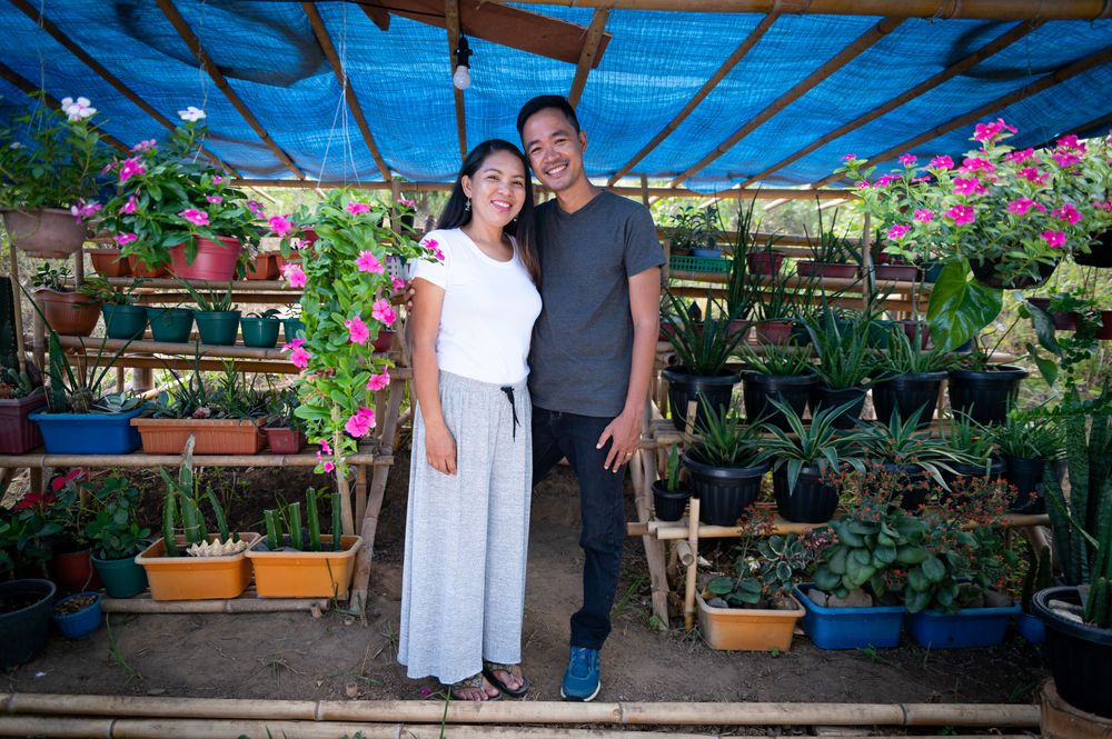 Philippines: Portrait of Philip and Levy Lim who lead the ministry in Palawan standing in the succulents. Photo by Alex Coleman. More Info