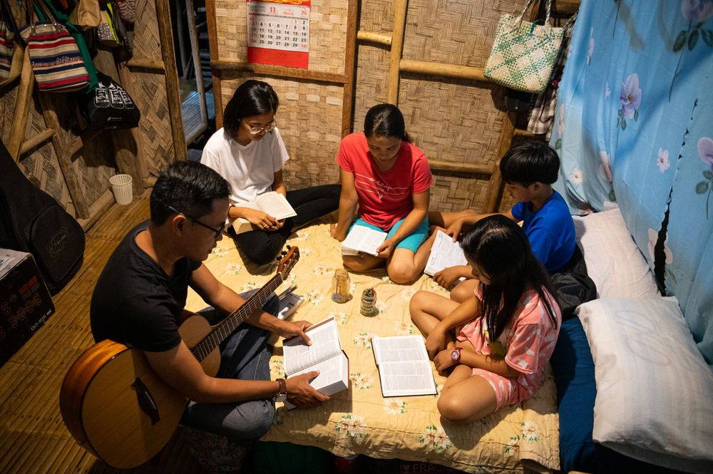 Philippines: The Lim family enjoying devotions with song and Bible study. Photo by Alex Coleman. More Info