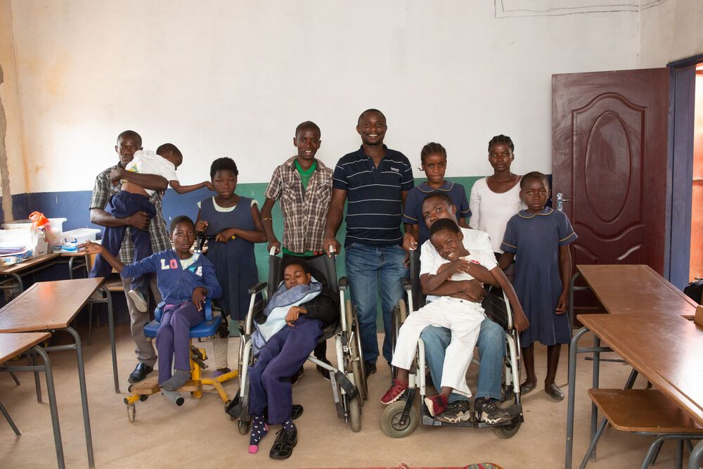 Peter Chila with the students at Bethesda Mercy ministry school for the disabled community in Zambia. Photo by Brad Livengood.