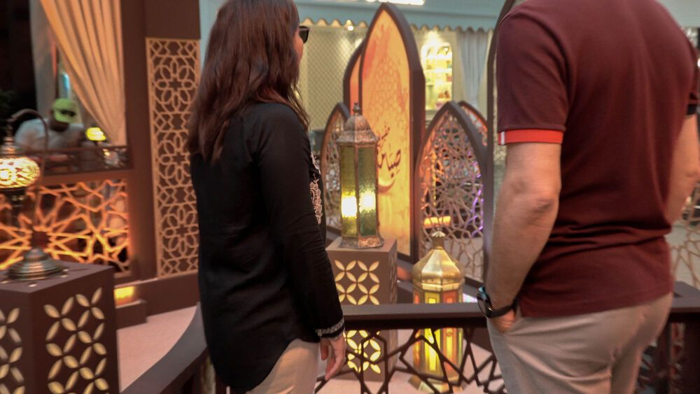 International: Two workers pause at a Ramadan display in a mall in the Middle East. Photo by Jay S. More Info