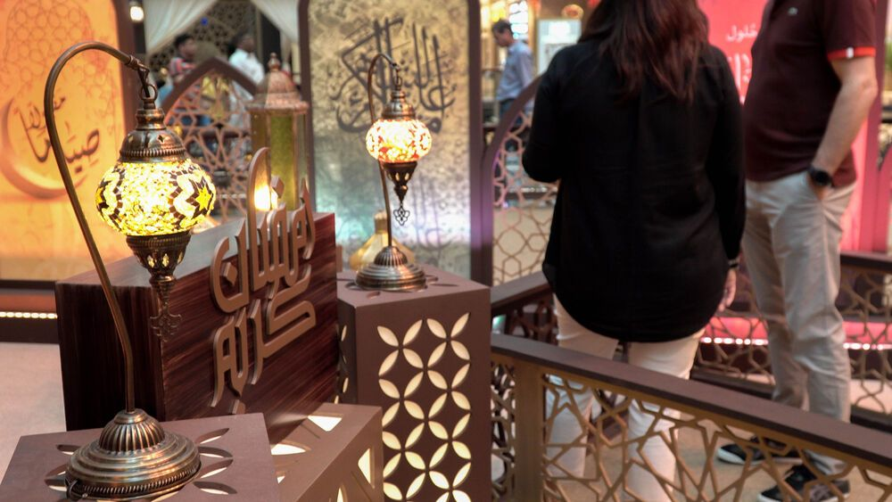 International: Workers pause at a Ramadan display in a mall in the Middle East. Photo by Jay S. More Info