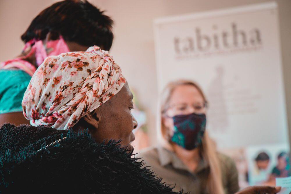 Zambia: Larissa Wiens, Womens Empowerment Coordinator, Africa Area, assisting local women. Photo by Kauya Mali. More Info