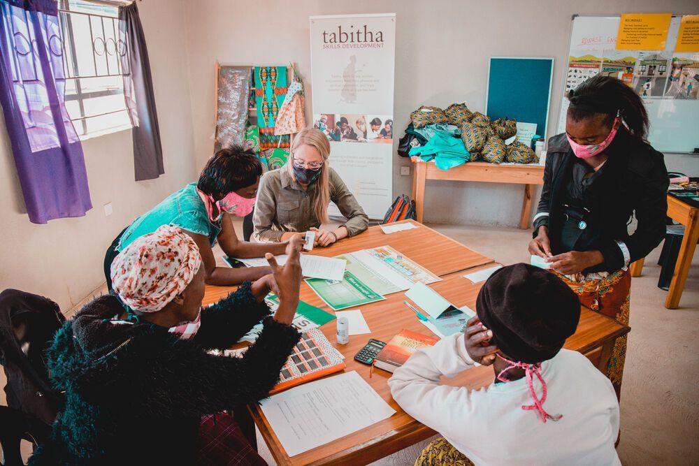 Zambia: Larissa Wiens, Womens Empowerment Coordinator, Africa Area assisting women. Photo by Kauya Mali. More Info