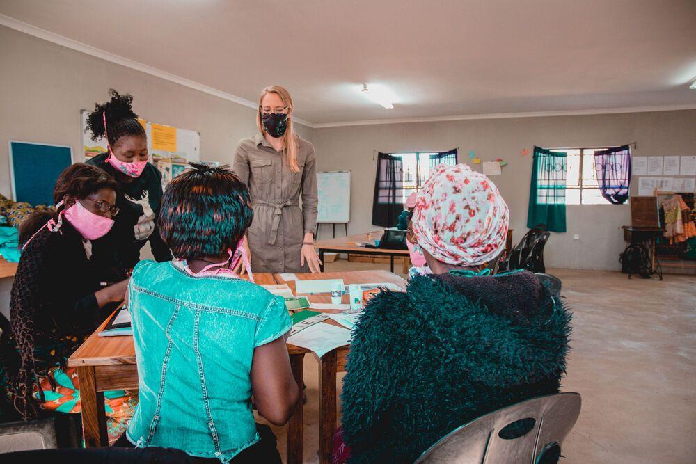Larissa Wiens, Womens Empowerment Coordinator, Africa Area, assisting local women. Photo by Kauya Mali.