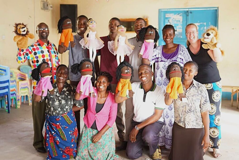 South Africa: Marleen also teaches skills to equip children workers and one of the skills is puppetry. Here she is with participants in Tanzania. Photo by Stephanie McWilliam More Info