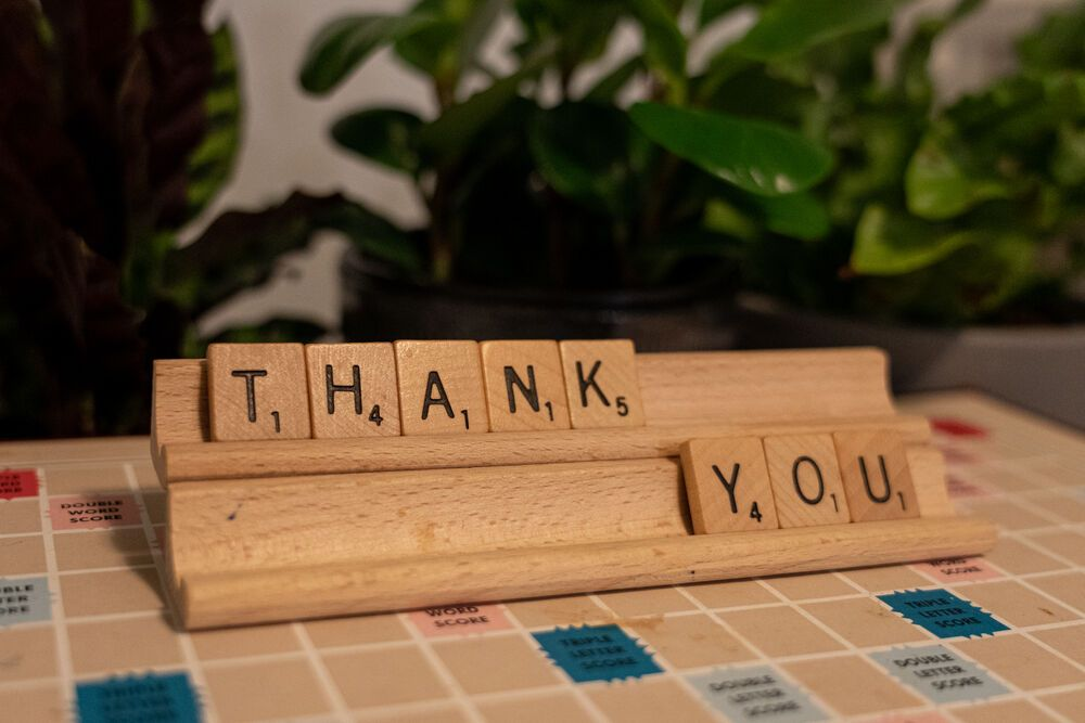 Thank You spelt out in Scrabble tiles. Photo by Rebecca Rempel.