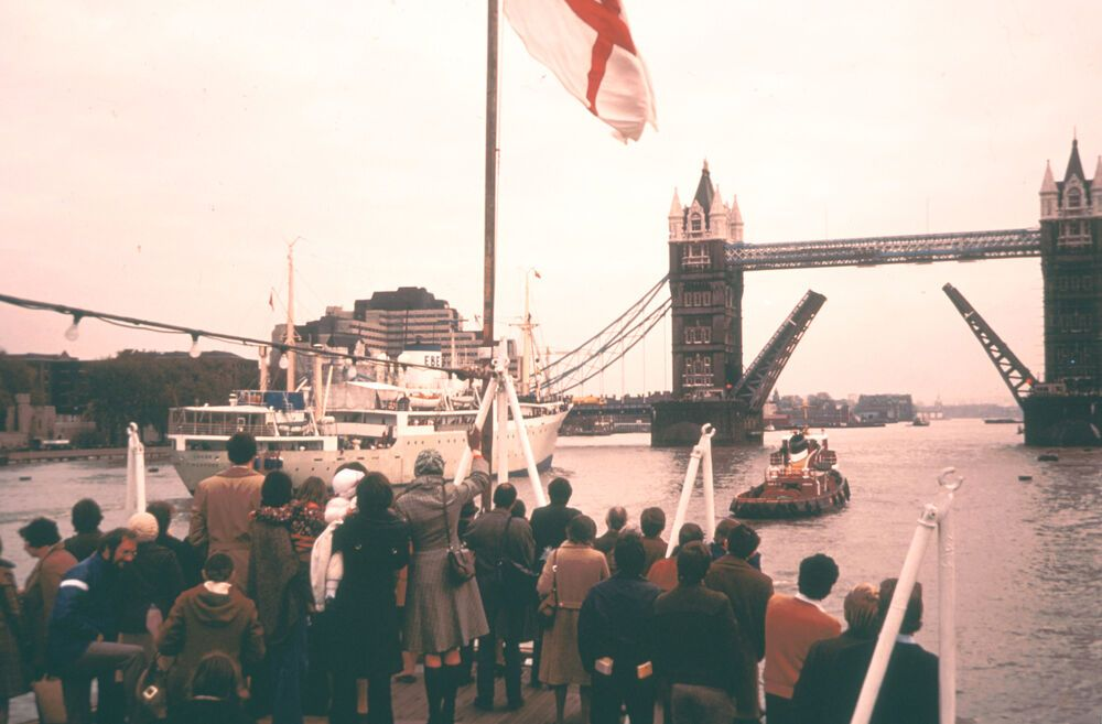 London, England :: OMs first ship, Logos, is waved off from London in late February 1971.