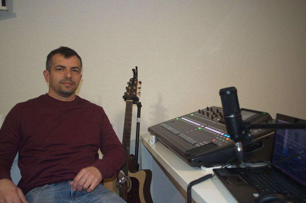 Montenegro: Yan from OM Montenegro operates the mixing desk at Mozaik church, Bar, Montenegro. More Info