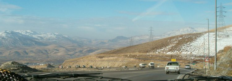 Iran: A wide shot of a highway through the mountains of Iran. More Info