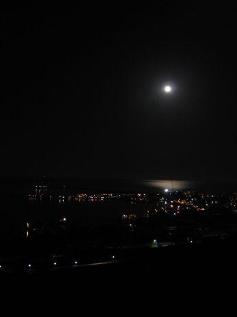 Caucasus: Full moon over Baku and the Caspian Sea More Info