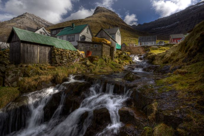 Faroe Is.: Tórshavn, Faroe Islands  ::  The town of Kunoy on the island of the same name has a series of waterfalls that run through. More Info