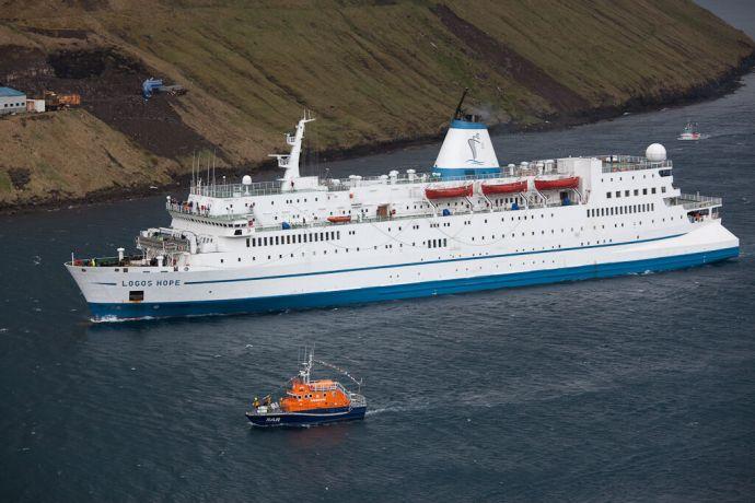 Faroe Is.: Klaksvik, Faroe Islands  ::  Accompanied by a Search and Rescue Boat the vessel makes her way to the berth in Klaksvik. More Info
