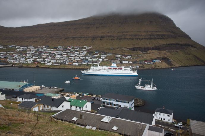 Faroe Is.: Klaksvik, Faroe Islands  ::  Accompanied by a Search and Rescue Boat and Juvell II as well as a couple of privatly owned boats the vessel makes her way to the berth in Klaksvik. More Info