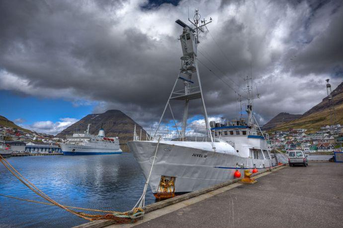 Faroe Is.: Klaksvik, Faroe Islands  ::  The smaller mission vessel Juvell II berthed a distance away from Logos Hope. More Info