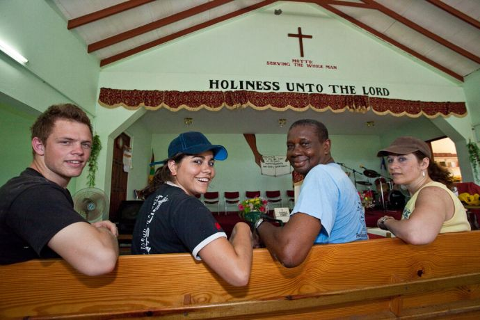 Grenada: St. Georges, Grenada :: Tony Fourie (South Africa), Sigrid Rodriguez (Mexico), Pastor Ashley Church and Pauline Scott (Scotland) sitting on the front pew of the Christian Grand Bacolet Evangelical Church. More Info