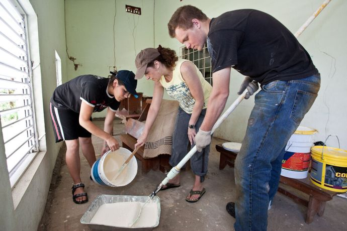 Grenada: St. Georges, Grenada :: Sigrid Rodriguez (Mexico), Pauline Scott (UK) and Tony Fourie (South Africa) working on painting the interior of the Christian Grand Bacolet Evangelical Church. More Info