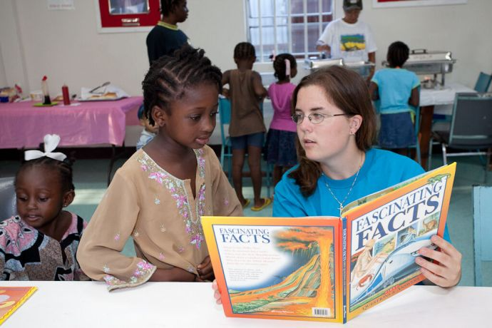 Barbados: Bridgetown, Barbados :: KC Leader (Canada) reading to one of the children at the Kids Breakfast Club. More Info