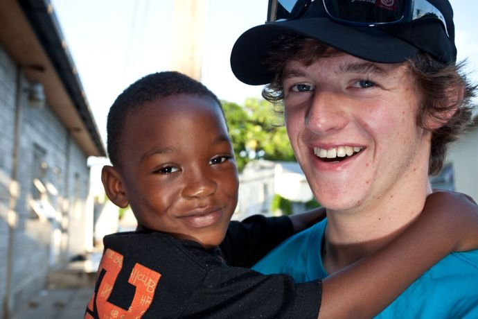 Barbados: Bridgetown, Barbados :: Sam Harper (UK) with one of the kids from the Kids Breakfast Club. More Info