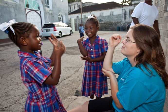 Barbados: Bridgetown, Barbados :: KC Leader (Canada) playing Simon Says with two kids from the Kids Breakfast Club. More Info