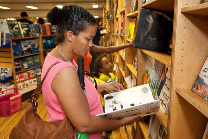 Barbados: Bridgetown, Barbados :: A local lady enjoys browsing the books. More Info