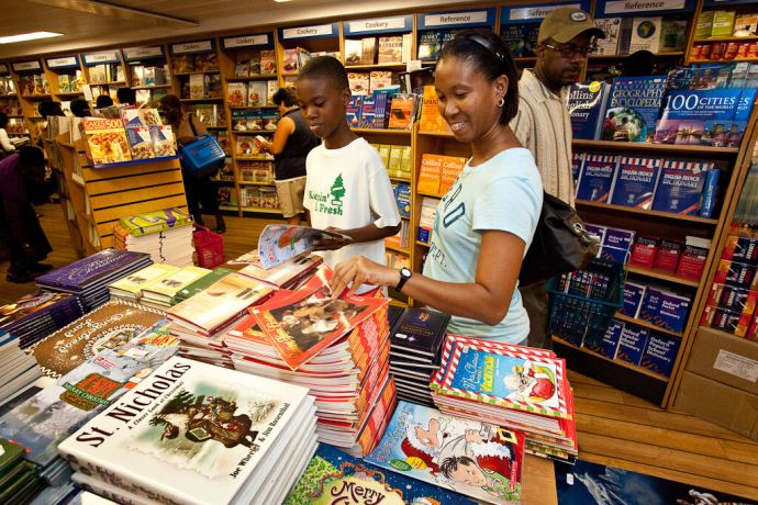 Barbados: Bridgetown, Barbados  ::  A lady and her son browsing the Christmas book selection. More Info