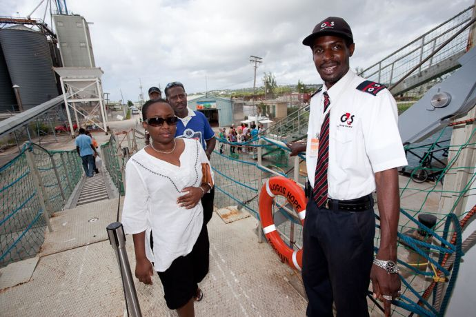 Barbados: Bridgetown, Barbados :: A hired security guard watching over the guests at the entrance to the Visitor Experience. More Info