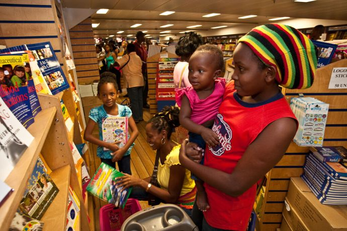 Barbados: Bridgetown, Barbados  ::  A mother and her daughters looking at the books. More Info