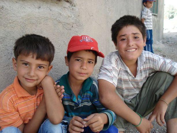 Iran: Three smiling Iranian boys More Info
