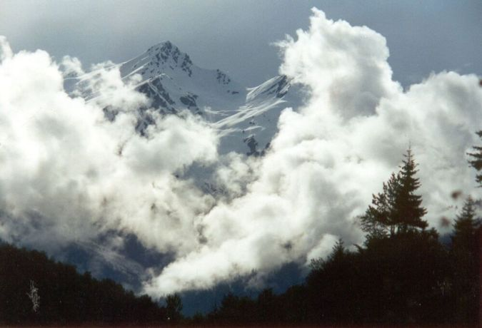 Caucasus: High mountain peak and clouds More Info