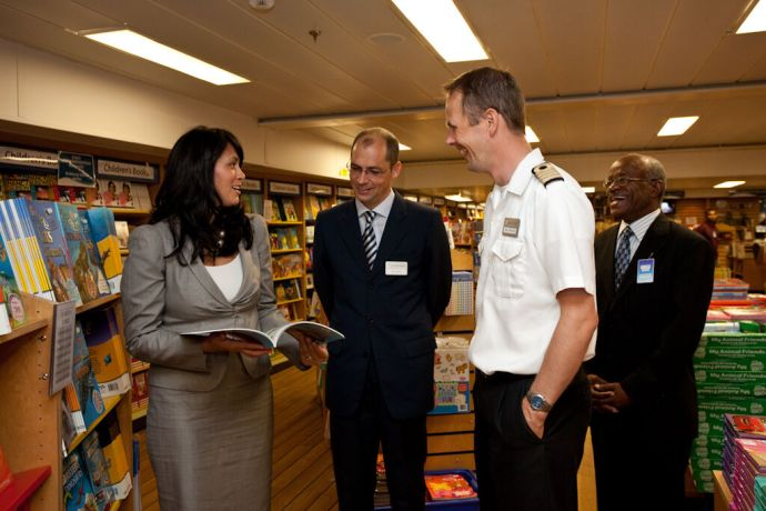 Aruba: Oranjestad, Aruba :: Minister of Economic Affairs, Social Affairs and Culture Michelle Winklaar together with Ships Director, Gian Walser, Captain Dirk Colenbrander and local pastor Cedric Charles in the book fair. More Info