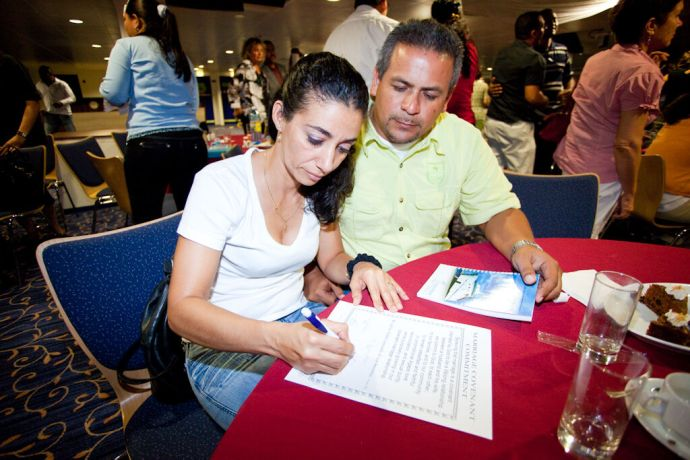 Aruba: Oranjestad, Aruba :: Local couple Alvin and  Beatriz Werleman sign a marriage covenant during the Keep the Fire! event. More Info