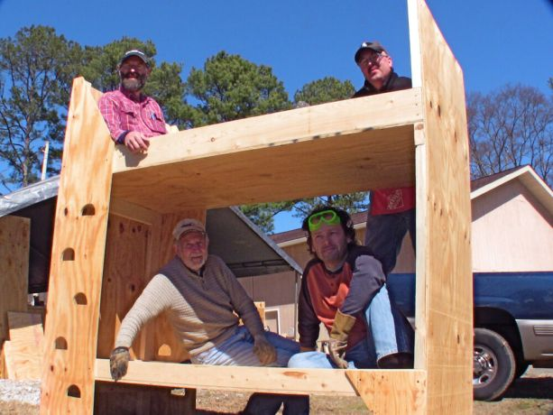United States: Members of the OM USA team show a finished bunk bed. 25 of these crates that convert to bunk beds are being sent to Haiti in a shipping container. More Info