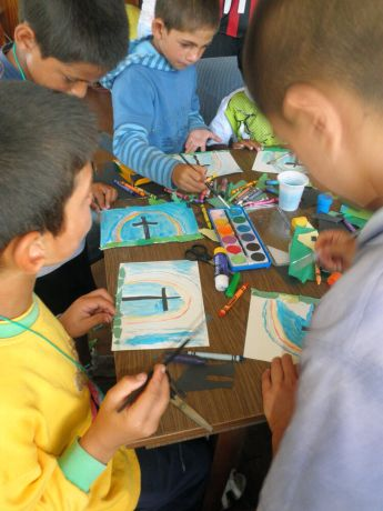 Bulgaria: A group of Bulgarian gypsy boys paint pictures during a summer camp organised as part of the Transform 2010 Outreach. More Info