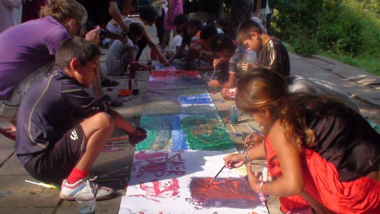 Bulgaria: Bulgarian gypsy children expressing themselves with paint More Info