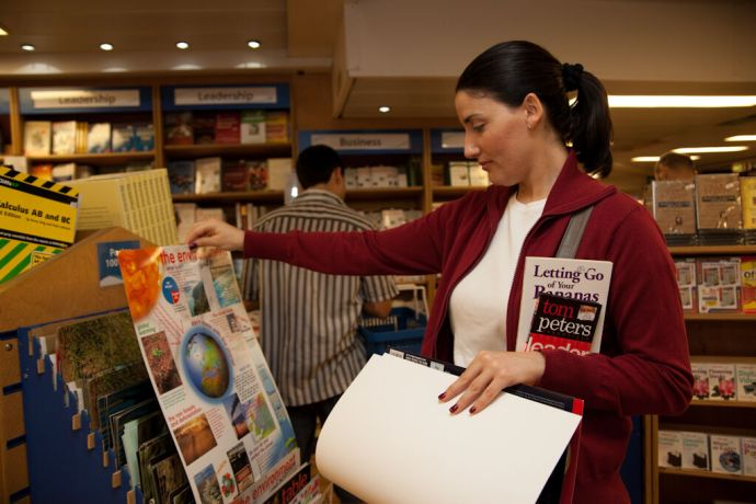 Malta: Valletta, Malta :: A local lady looks at a poster in the Book Fair. More Info