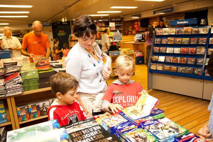Malta: Valletta, Malta :: A local family browses some books in the Book Fair. More Info