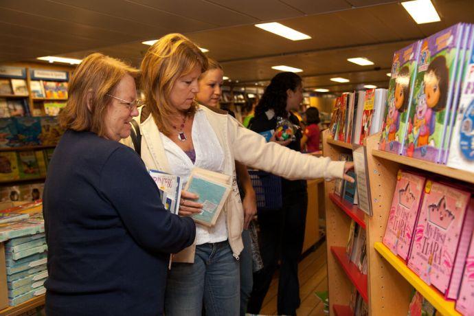 Malta: Valletta, Malta :: Two local ladies browse some books in the Book Fair. More Info