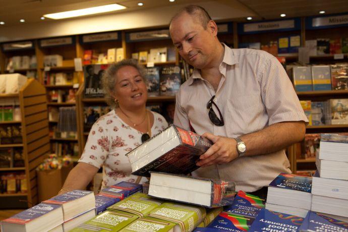 Malta: Valletta, Malta :: Locals look at a dictionary in the Book Fair. More Info