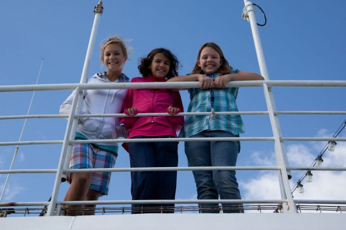 Malta: Valletta, Malta :: Left to right Annika Grebe (USA), Ester Lugao (Brazil) and Amy Müller (USA) smile for the camera on the roof deck. More Info