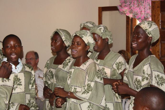 Mozambique: Missions graduation ceremony with choir performing. More Info