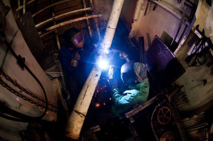 Malta: Valletta, Malta :: Welders Brad Rickman (Canada) and Jonathan Verwer (USA) work together in the Engine Room. More Info