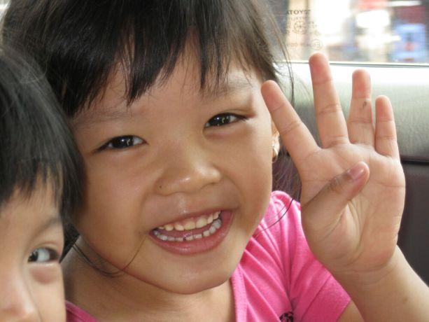 Vietnam: Little girl in Vietnam, smiling closeup More Info