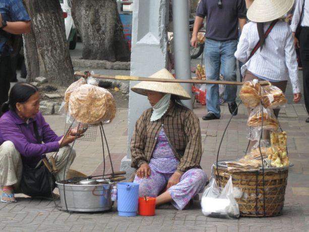 Vietnam: Woman street vender, Vietnam More Info