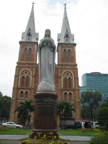 Vietnam: Notre Dame Cathedral,best known Catholic church in Ho Chi Minh City, Vietnam. With statue of Mary in foreground More Info