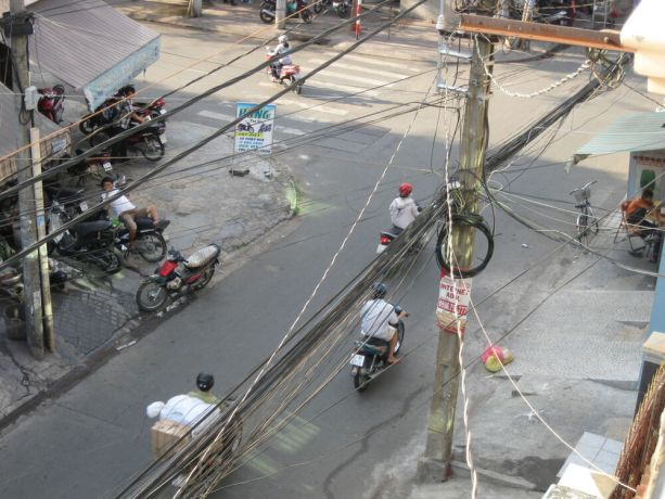 Vietnam: Electrical wires and pole, Ho Chin Minh City, Vietnam More Info