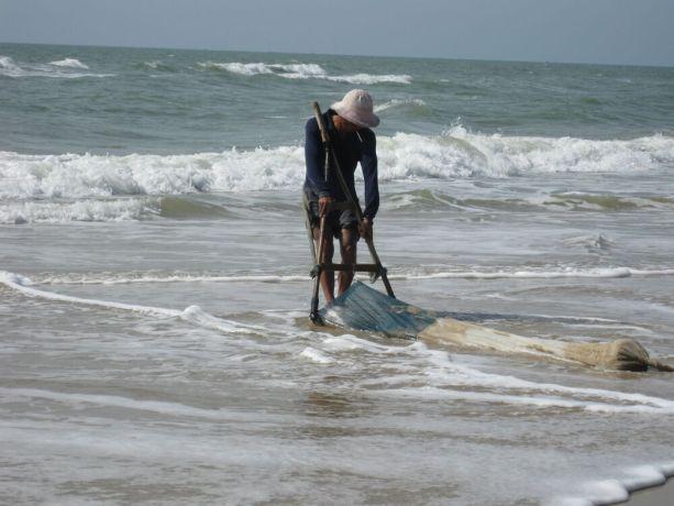 Vietnam: Fisherman on beach, Vietnam More Info